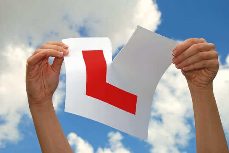 A learning tearing up the learner sign